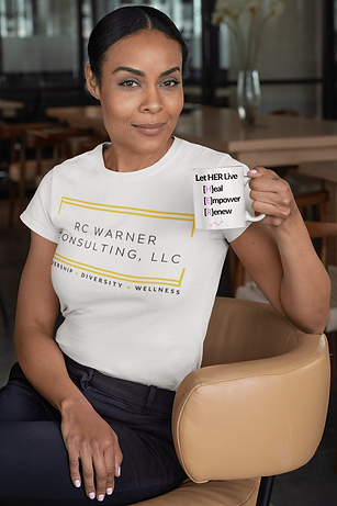 t-shirt-mockup-of-a-woman-sitting-on-a-chair-holding-an-11-oz-coffee-mug-31705 (1).png