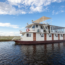 Exclusive charter house boat sails the Chobe River in all its glory.