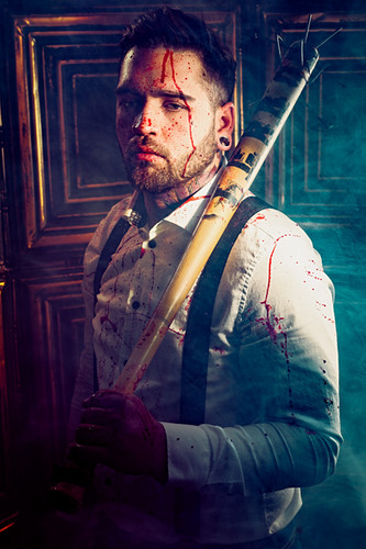 A blood splattered badass man stands holding a spiked baseball bat in this horror movie inspired editorial photo by Dillon Vance