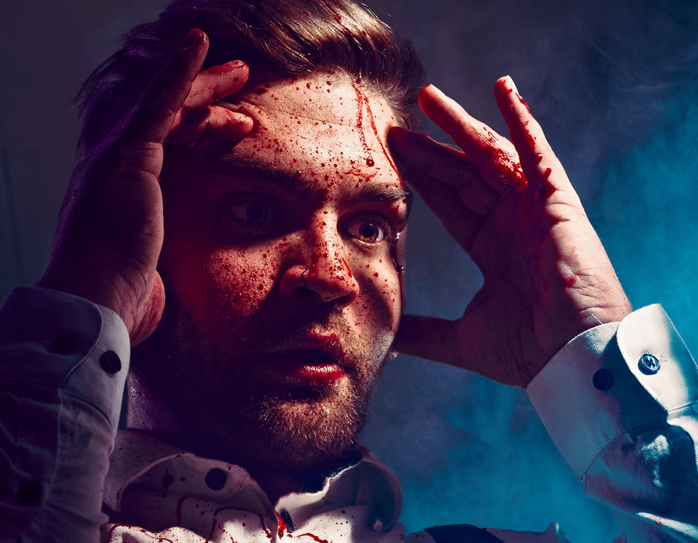 A Man shocked man is splattered with blood in this horror inspired portrait.