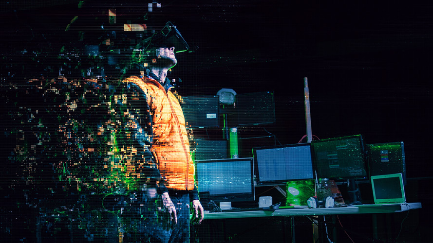 A Hacker Is getting uploaded into cyberspace or virtual reality as he turns into pixels in this surreal commercial photo