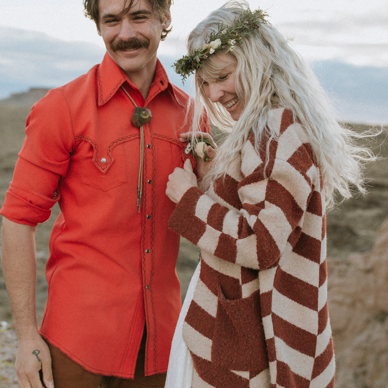 Bride and groom wear earthy inspired pieces for their desert canyon elopement.