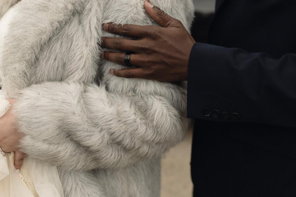 Fur coat over wedding dress.