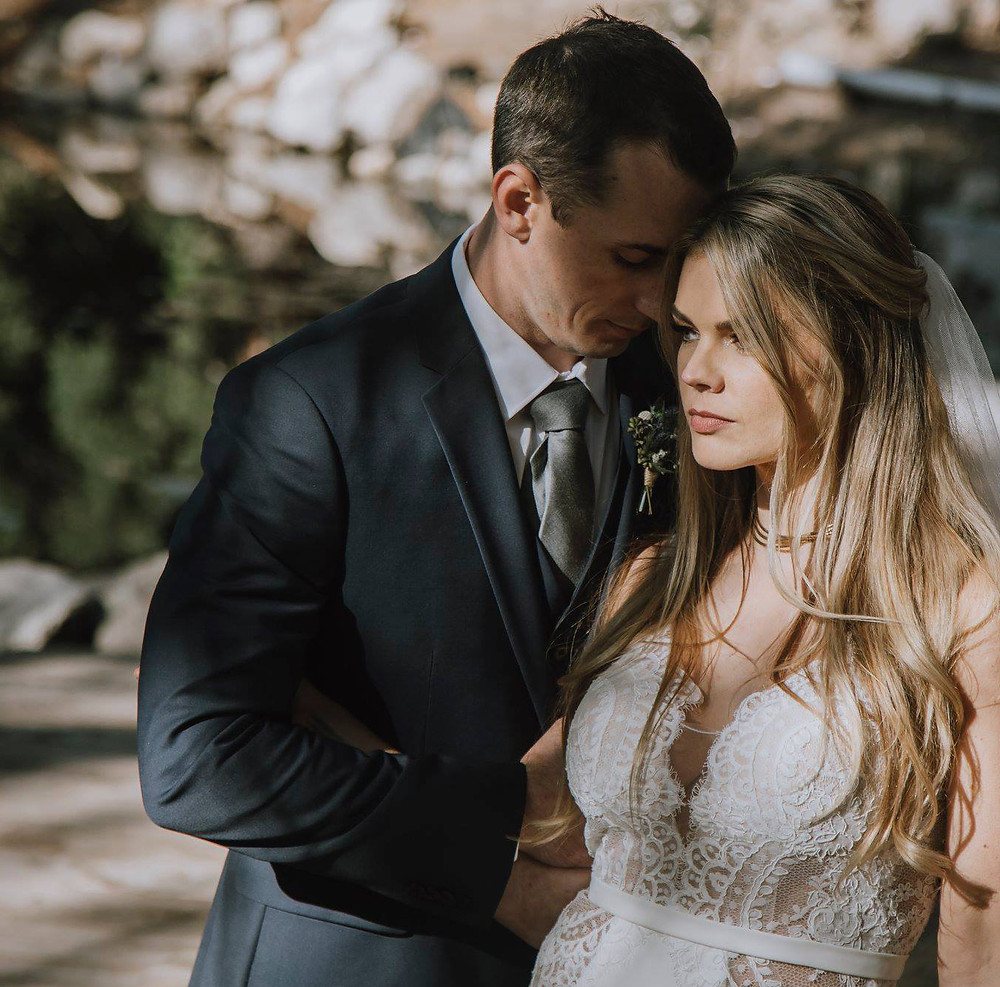 Antiqued gold necklace pairs well with a vintage lace wedding dress.