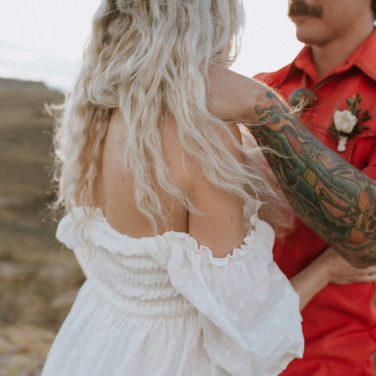 Fall off the shoulder dresses are perfect for a bohemian bride.