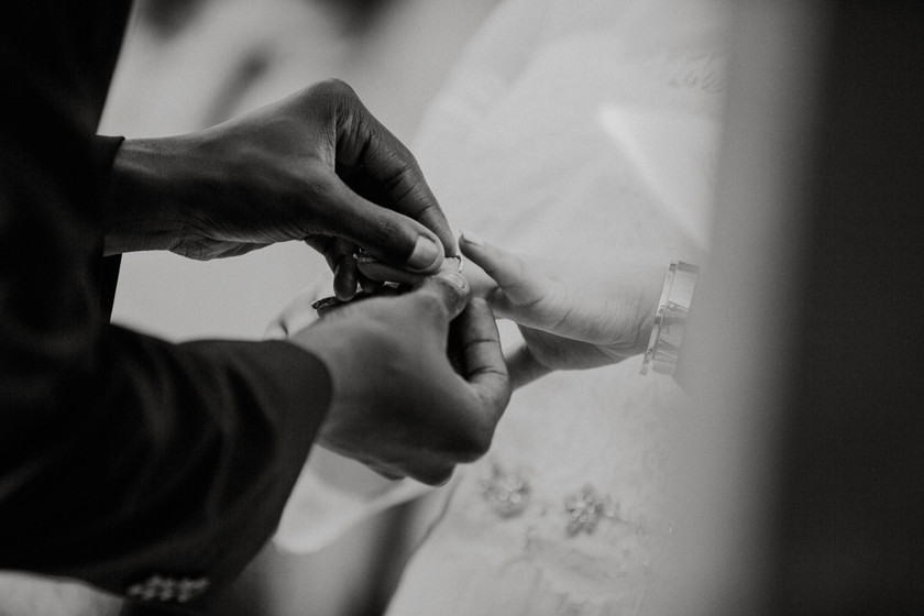 Groom gives her a ring To show his love during a private elopement ceremony.