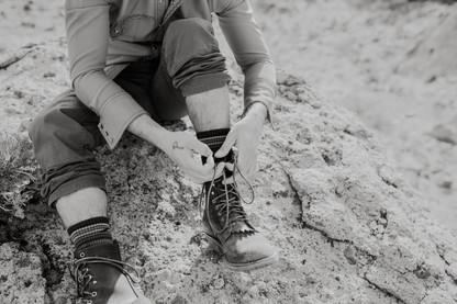 Groom puts on boots Perfect for his desert elopement.