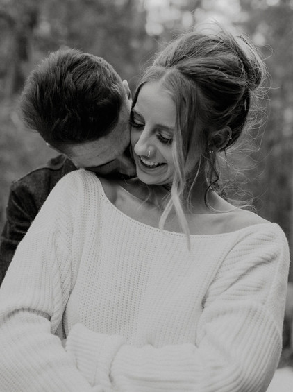 Gentle kisses on her neck brings authentic smiles