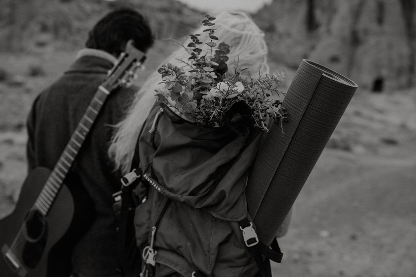 Bohemian bouquet in a backpack with a guitar and a yoga mat.