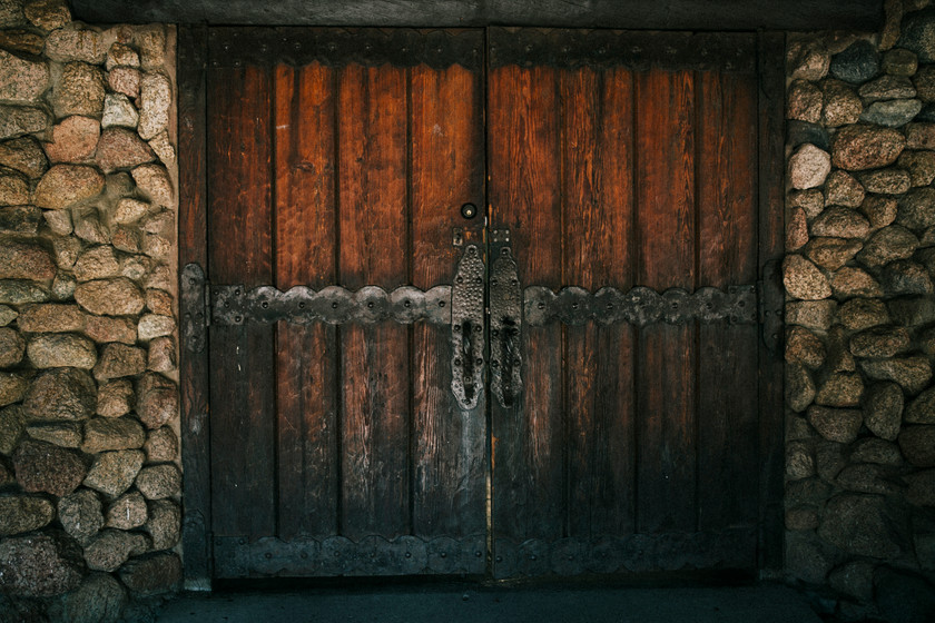 An old wooden door that creates the perfect ambience for a reception