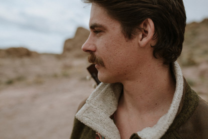 Groom with Mustache Hiking in the desert canyon perfect for an elopement location.