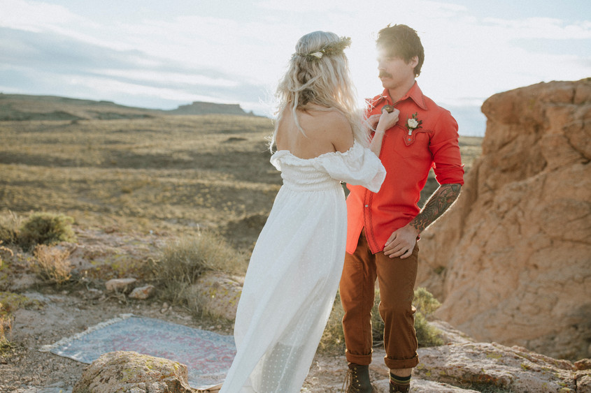 Sun flare In Desert Is the most amazing lighting for an elopement.