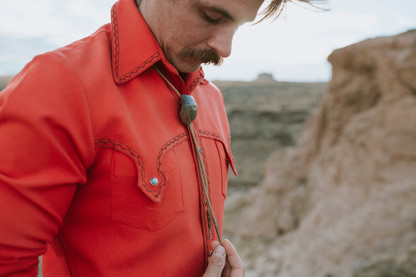 Bolo tie and western shirt for a free spirited man who loves retro style.