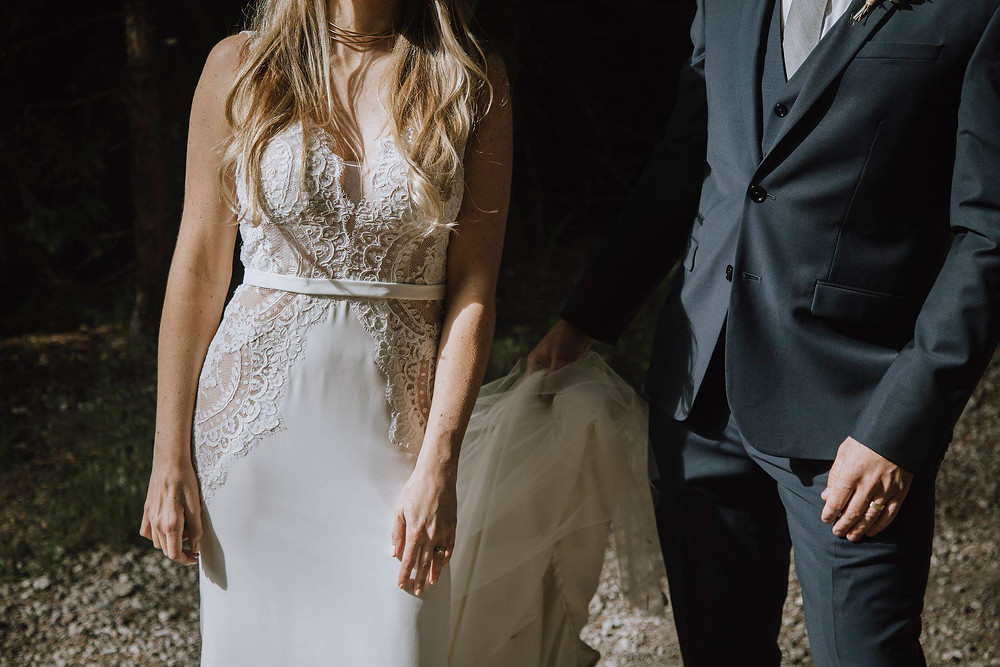 Grooms blue tuxedo compliments a lace wedding dress.