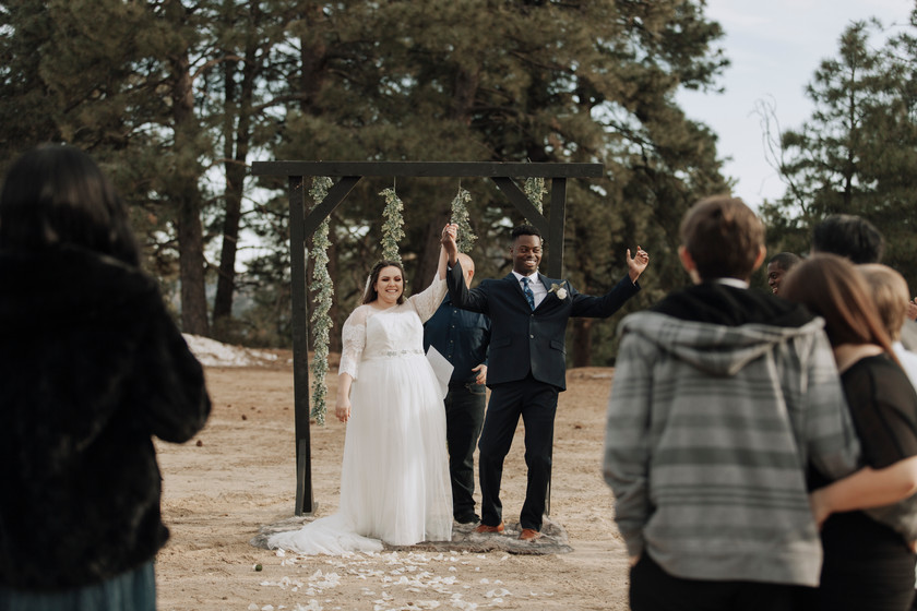 Bride and groom are married In an intimate and small wedding in the mountains.