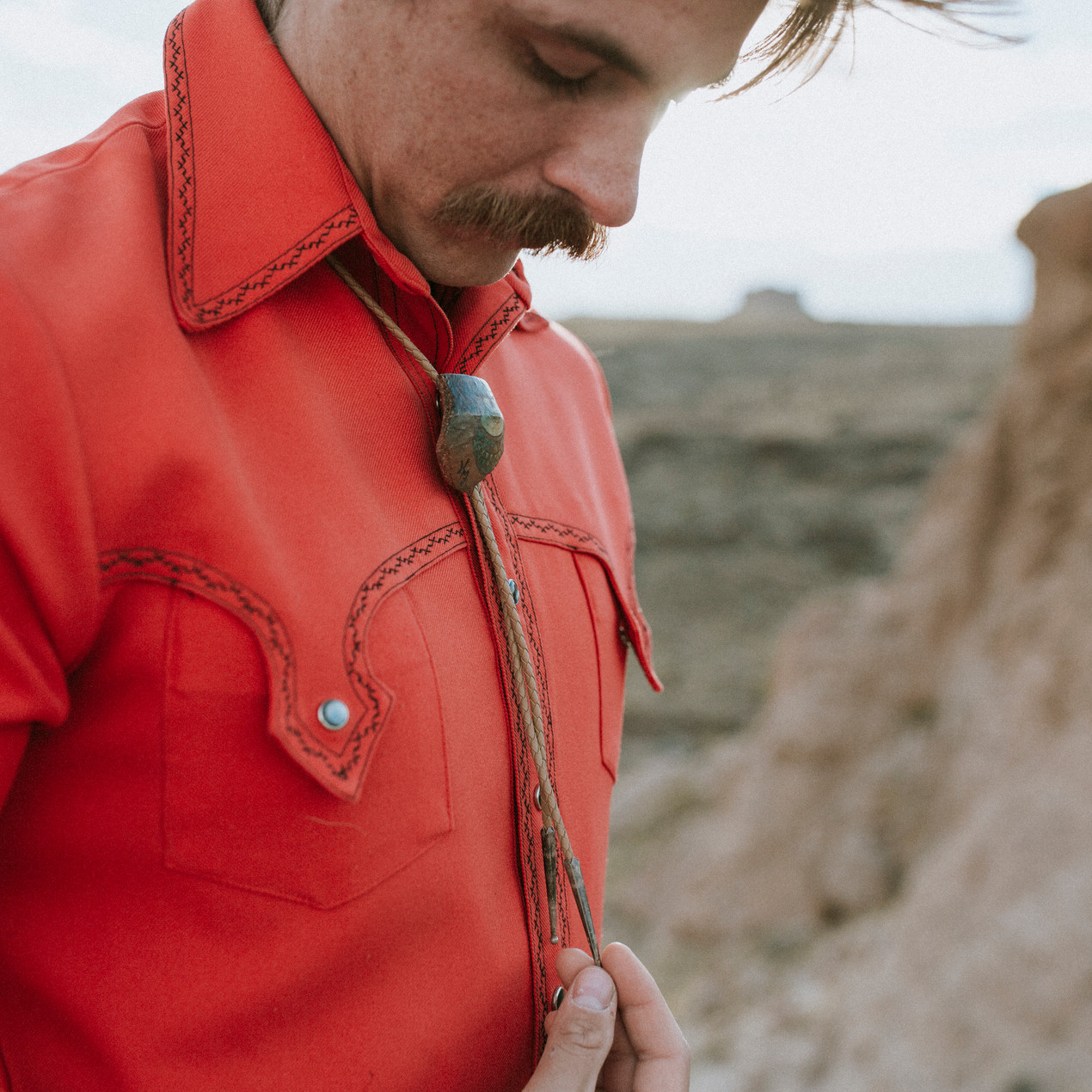 Groom accessorizes with a bolo tie for his elopement wedding.