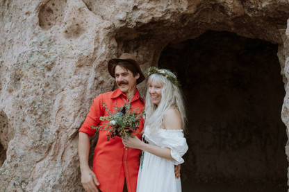 Retro couple get married In a desert canyon along route 66.