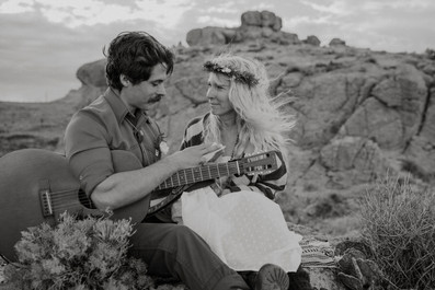 Groom says his vows On top of a desert canyon to his bohemian bride.
