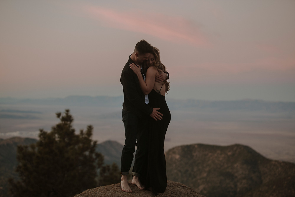 Bride wears black wedding dress for mountain elopement.