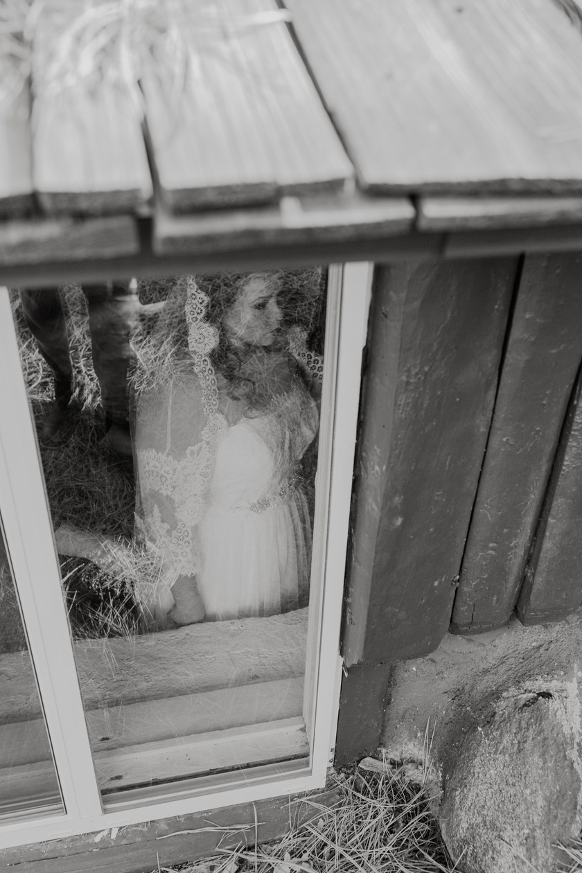 Bride takes a moment To breathe before the ceremony begins in a small and intimate wedding in the mountains.