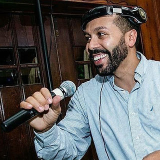 Julian on mic at Wedding.jpg