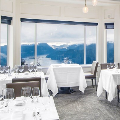 The Summit Restaurant at the Eyrie Resort offers breathtaking views of the Olympic Mountains over the fjordlands of Finlayson Arm & the Saanich Inlet.