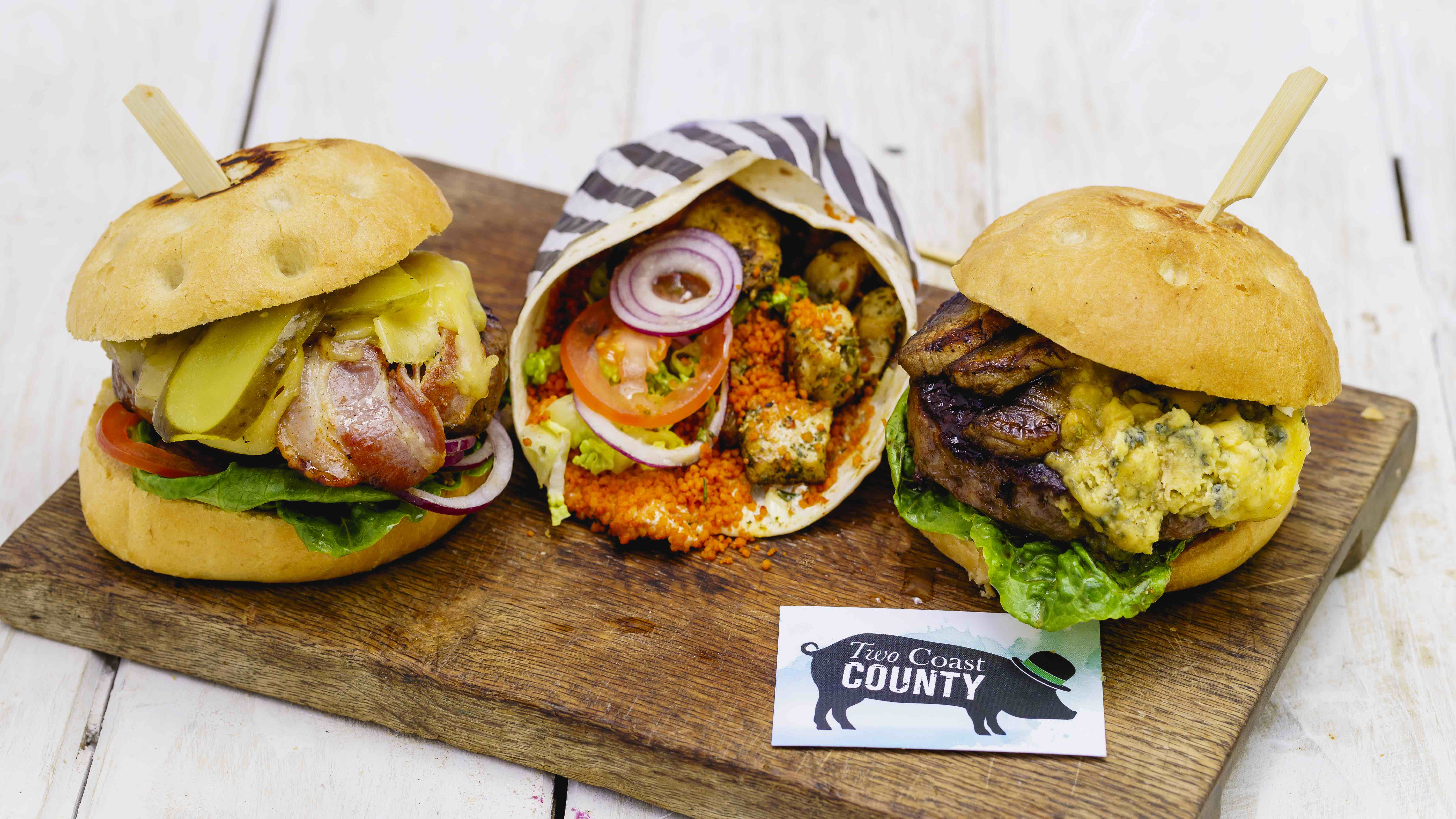 three burgers on a board
