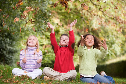 group-of-children-playing-amongst-autumn