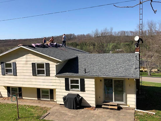 A recent project by Valley Roofing, light grey roof over light yellow siding and dark shutters