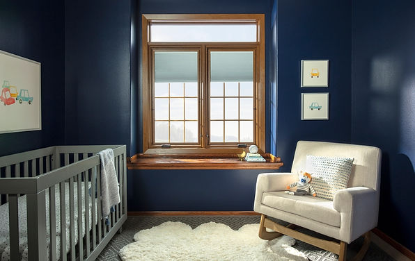 Pella window over a navy, grey and white accented room - image by Pella
