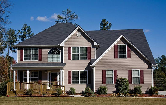 Mid-America Shutters red on a dark roof over tan house