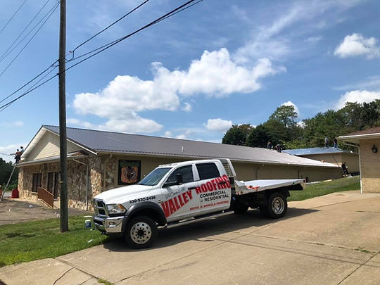 Valley Roofing Truck in front of a brand new metal roof in Calcutta, Ohio