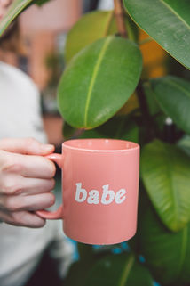 photo-of-person-holding-pink-mug-3747148