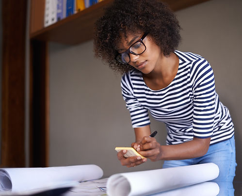 Young Woman Making Notes