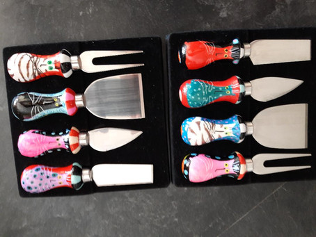 Cheese knives - because when you think of cats, you think of cheese, right?