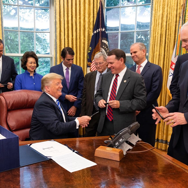 President Trump gives Graves the Signing Pen