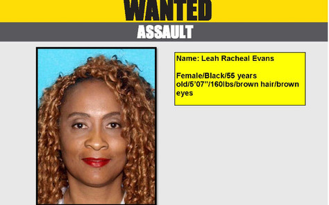 Wanted for assaulting her husband and has two warrants out for her arrest