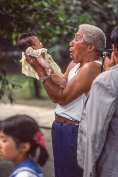 Chengdu - Man with Baby.jpg