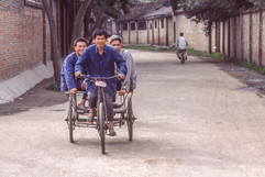 Chengdu - Men on Tricycle.jpg