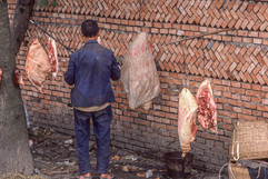 Chengdu - Man in Meat Market.jpg