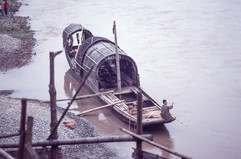 Leshan - Sampan with Fisherman in Port.j