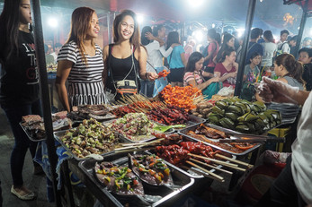 Customers at a street food kiosk, Davao City Philippines
