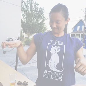 """Photo of Nicole wearing a t-shirt that read, """"T-Rex also hates pull-ups""""."""