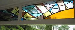 ondergaande zon glas in lood