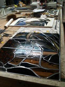glazenier aan het werk