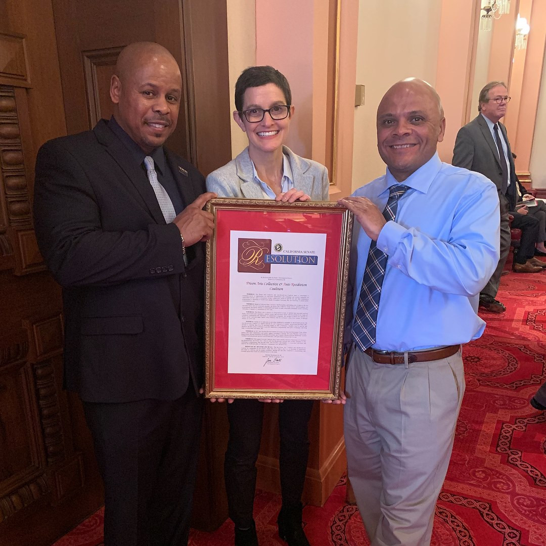 Sam Lewis (ARC), Annie Buckley (PAC), and Mark Taylor holding the official certificate of recognition form the California State Senate.