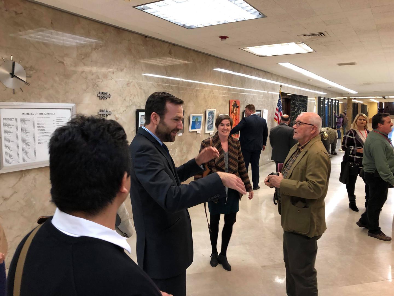 Senator Ben Allen with spectators learning about the artwork.