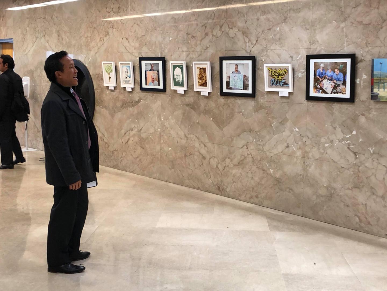Assemblymember David Chiu looking at the exhibit.