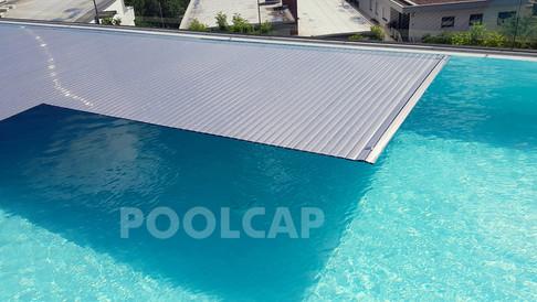 Poolabdeckung Rolloabdeckung Polycarbonat 15/62,5 mm Anti-Algen-Solar silbrig. Welle in einer Beckenverlängerung unten
