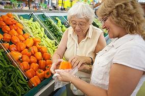 Senior-Woman-Shopping-with-Caregiver.jpg